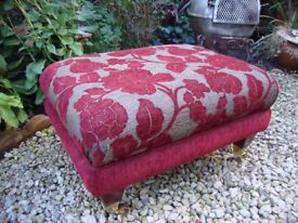 Large Upholstered Pouffe,With Brass Wheels.