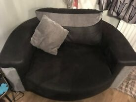 Swivel (cuddler) chair, black and grey, seats up to two people, £200.