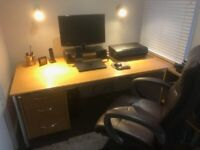 Large office desk with drawers.