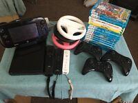 Nintendo Wii U plus games and remotes