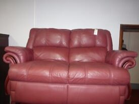 A lovely red velvet three piece suite with recliner chairs.