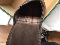 Men's Moshulu slippers size 9.5 leather except for soles.