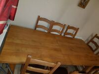 Solid Oak Extendable Dining Table & 8 Leather Seated Chairs