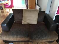 Brown sofa with cushions