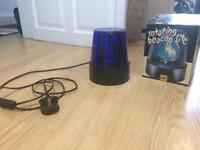 Blue rotating beacon light