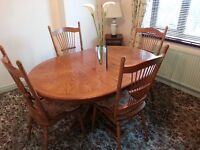 Oval and Round Decorative Wooden Dining Room Table and Chairs.