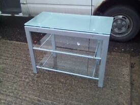Chrome and glass table with 2 shelves. 900mm wide