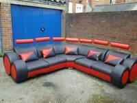 Stunning 1 month old black red leather corner sofa .unique design.can deliver