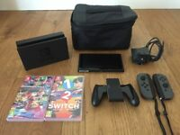 Nintendo Switch + 2 games + carry case
