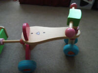 Wooden ride on bike and trailor, excellent condition