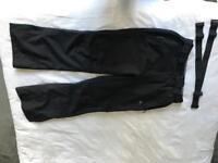 Men's black ski salopettes