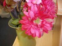 PLASTIC FLOWERS IN JUG