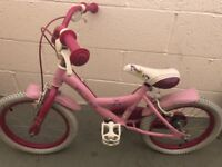 Pink child's bike for sale
