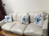 White leather sofa- well worn- really comfy