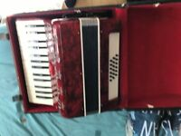 lovely red accordion with a nice carry case