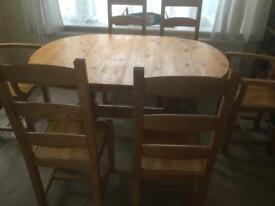 Solid wood pine extendable dining table complete with 6 solid pine dining chairs
