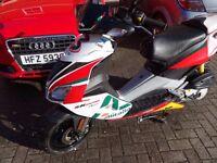 Aprilia SR50 R Max Biaggi replica colours.