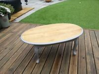 Oval coffee table, solid wood painted light grey with varnished top