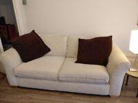 Cream sofa in excellent condition