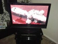 "Panasonic 37"" TV with black glass and chrome stand"