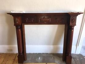 Period style wooden fireplace / fire surround / mantlepiece