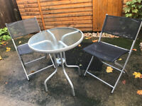 Garden / Patio Set - Glass table & 2 folding chairs - 4 months old