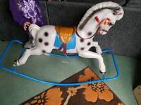 vintage plastic rocking horse metal base