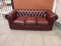 A Saxon Brown Leather Chesterfield Three Seater Sofa