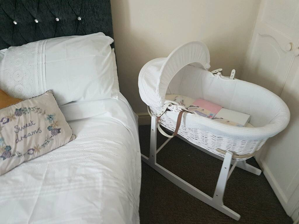 Ivory white moses basket, matching stand and two moses basket sheets