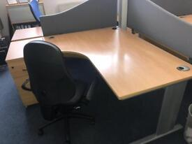 Professional office table with drawers and chair included. Delivery options available