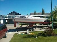 San Juan 7.7 with superb trailer, new mast, excellent sails