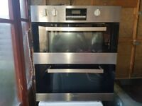 CANDY ELECTRIC INTEGRATED ELECTRIC DOUBLE OVEN. REFURBISHED. COMES WITH FREE WARRANTY.