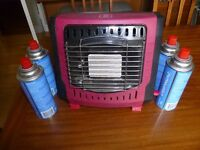 small gas fire with 4 canisters used in caravan