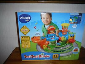 V-TECH toot toot driver garage, New box unopened. blue,orange, green in colour, 1 tow truck age 1/5