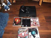 playstation 3 with 5 games 2 controllers