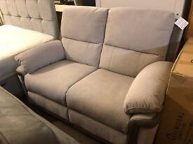 Ex-display** Stunning fabric reclining 2 seater sofa BARGAIN