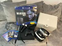 PS4 Pro 1TB VR bundle and move sticks plus 3 games and boxed