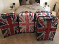 4 x large hard shell suitcases