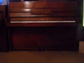 upright piano by j broadwood