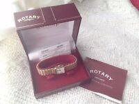 Ladies 9ct gold watch with documents, original case and spare parts to make bracelet longer