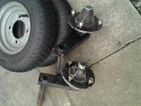Trailer axles and wheels