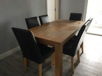 Oak table and 6 dark brown leather chairs