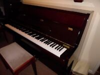 upright piano by hyundai-- showroom condition