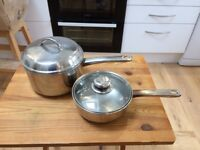2 litre and 1 litre stainless steel saucepans with lids.