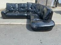 BLACK LEATHER CORNER SOFA USED IN REASONABLE CONDITION