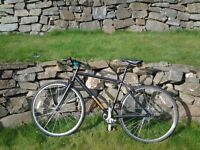 Two mens bikes black one unwanter gift cost £225 white in need of repair