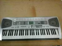 Casio Digital Light Up Keyboard System LK55 with song book and song book stand