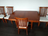 Wood extending dining table and 6 chairs