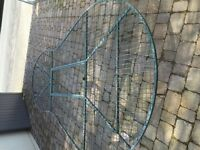 "Large green metal ""grid"" type pond cover."