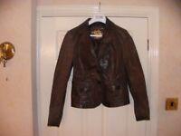 ladies short leather jacket.